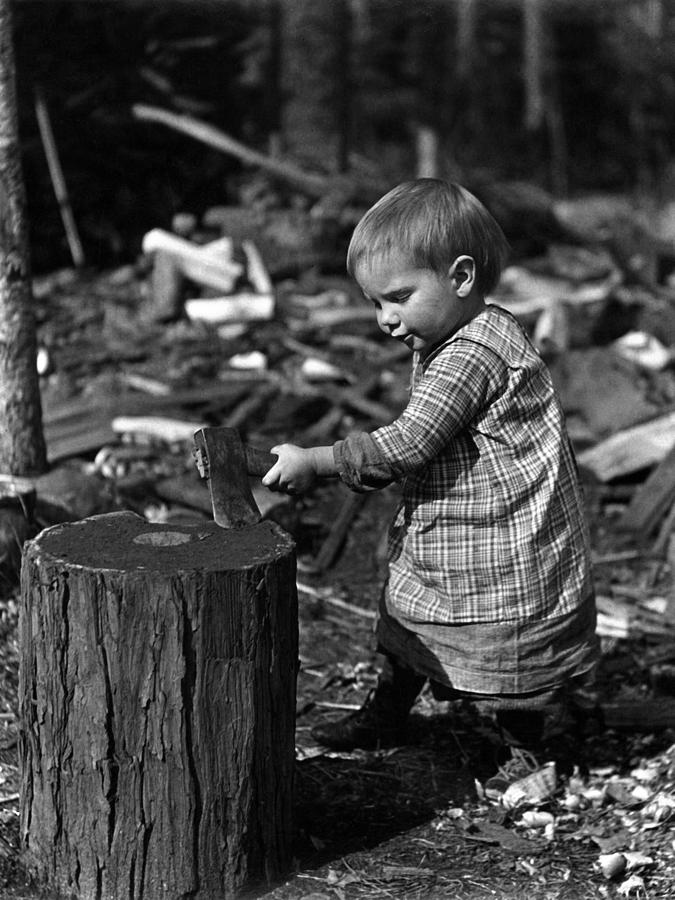 Toddler photograph toddler chopping wood 1900s black white archive by mark goebel