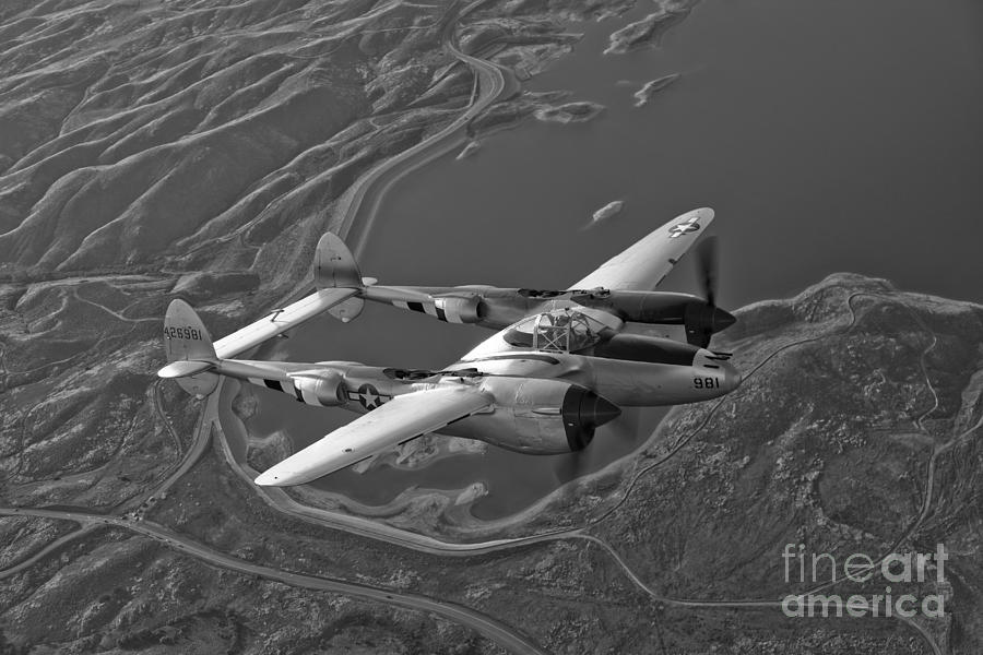 Black And White Photograph - A Lockheed P-38 Lightning Fighter by Scott Germain