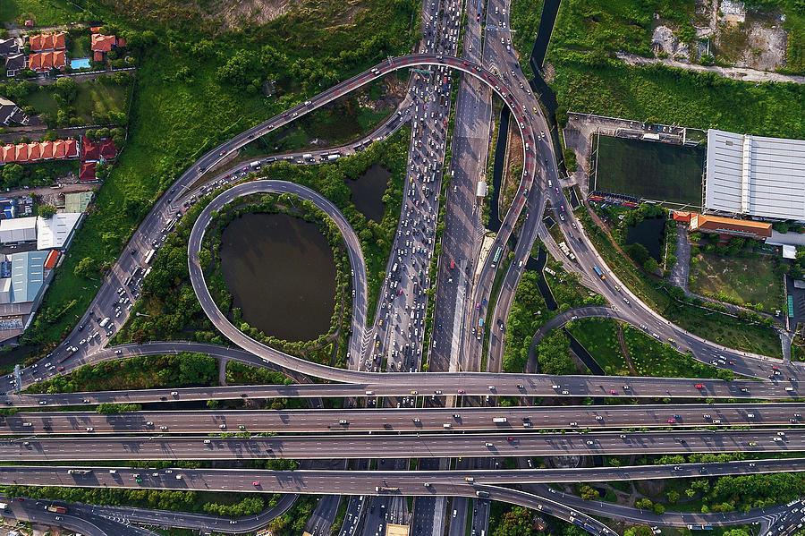 Aerial view of traffic jams at Nonthaburi intersection in the evening, Bangkok. by Pradeep Raja PRINTS
