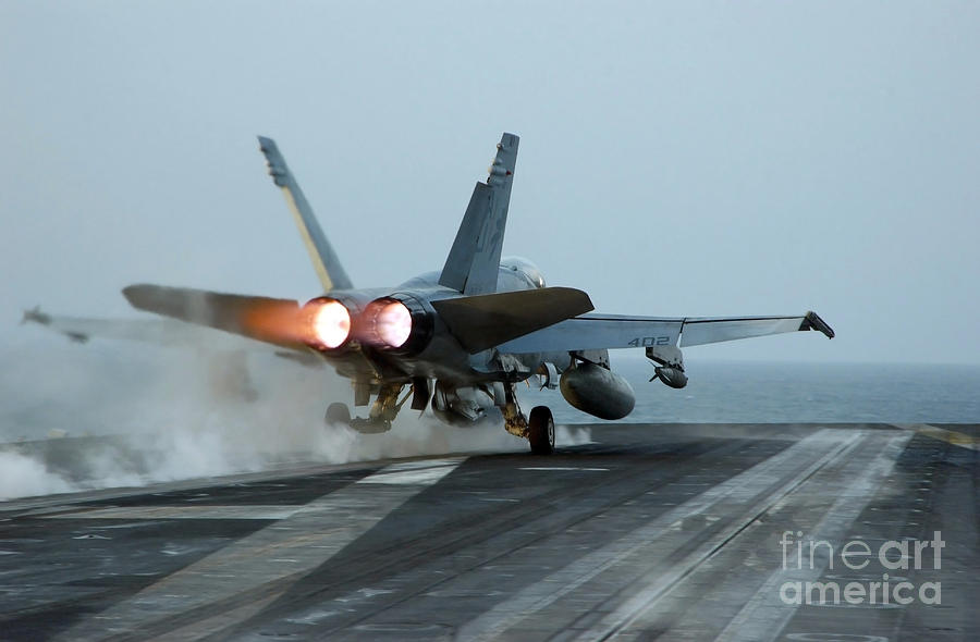 Color Image Photograph - An Fa-18 Hornet Launches by Stocktrek Images