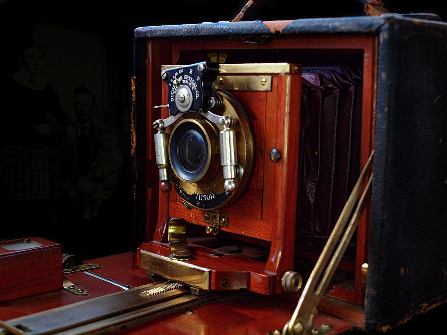 Antique folding camera by Gary De Capua