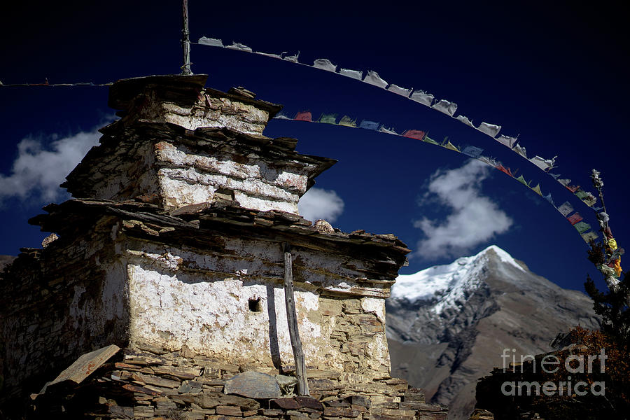 Buddhist gompa and prayer flags in the Himalaya mountains, Nepal by Raimond Klavins