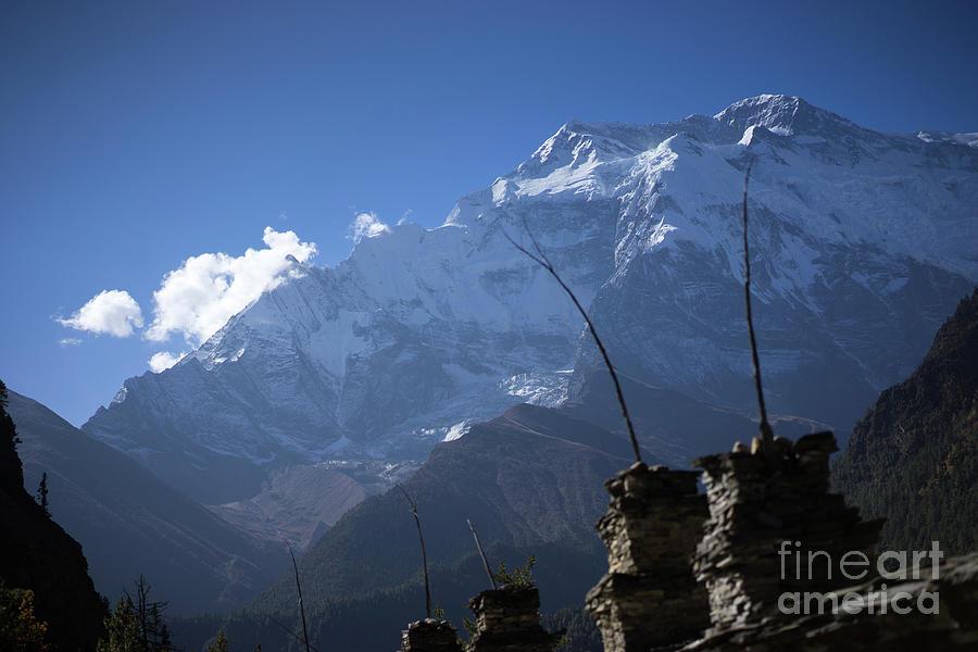 Buddhist gompa and prayer flags in the Himalaya range, Annapurna region, Nepal by Raimond Klavins