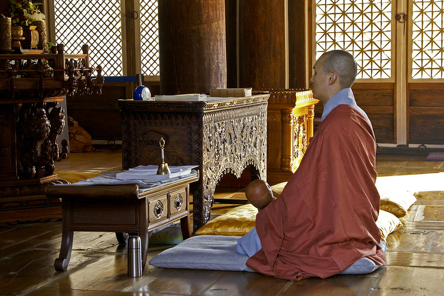 Asia Photograph - Buddhist Monk In Prayer by Michele Burgess