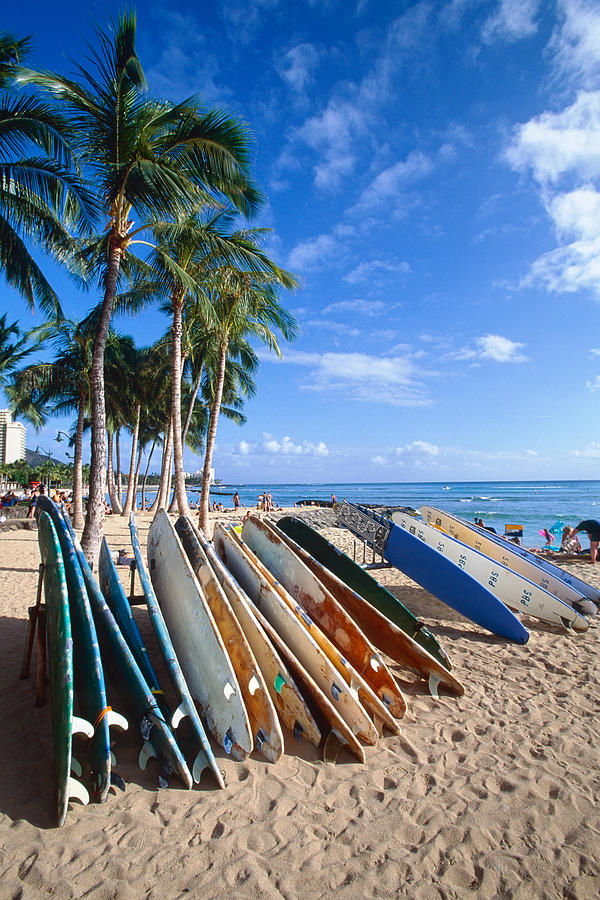 Beach Photograph - Colorful Surfboards On Waikiki Beach by George Oze
