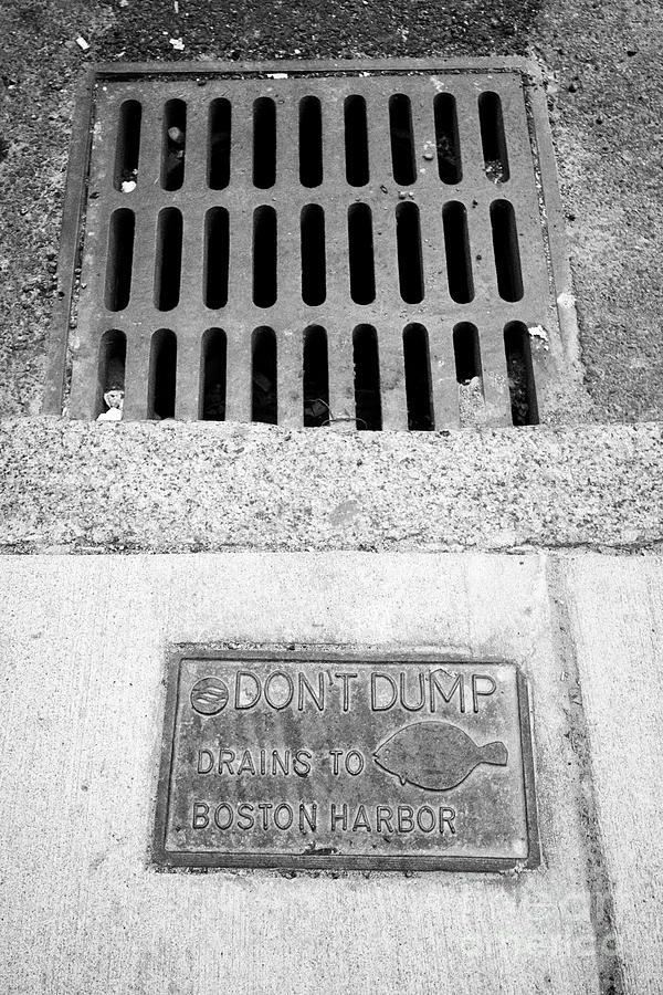dont dump drains to boston harbor sign next to street level storm water  drain Boston USA