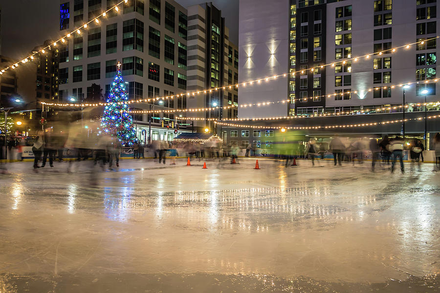 Ice Skating Photograph - Holiday Scenes In Uptown Charlotte North Carolina by Alex Grichenko