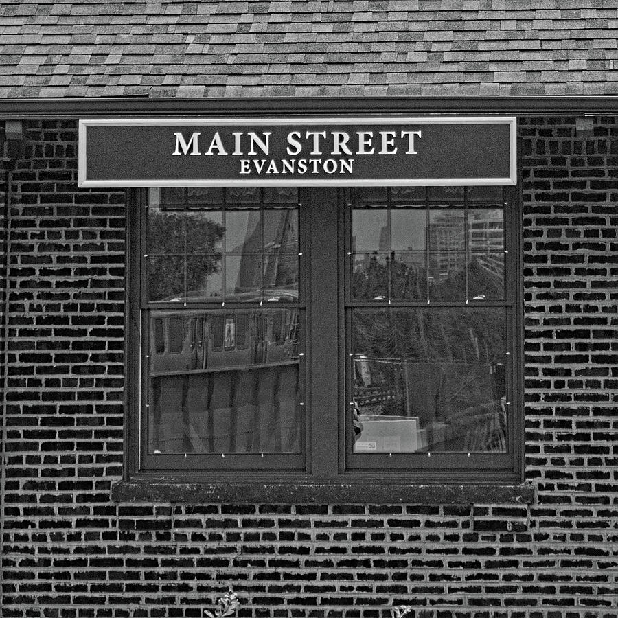 Black And White Photograph - Main Street Station by Michael Flood