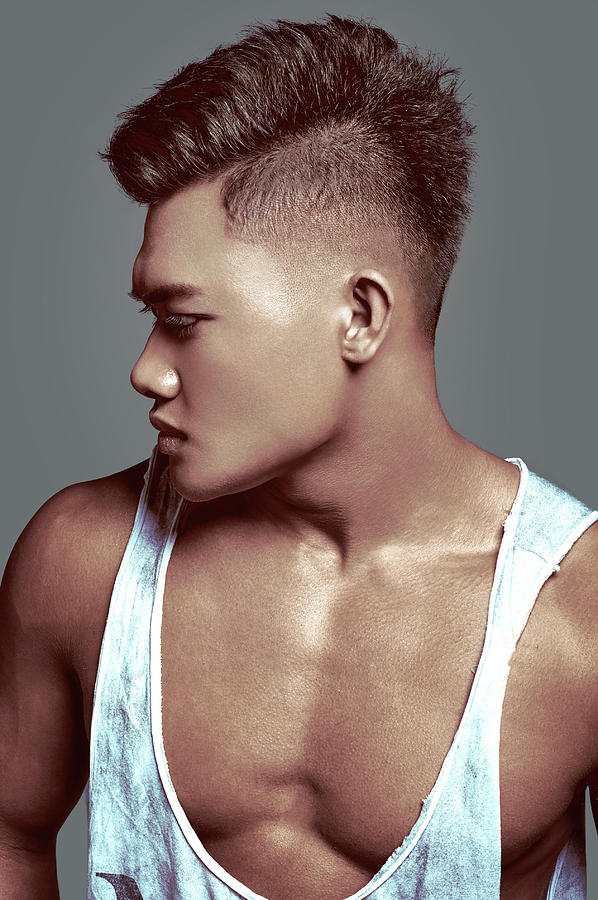 Man With Short Back And Sides Hairstyle Layer On Top by Gemree Mangilit