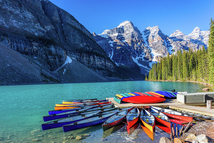 Moraine Lake Canoes Photograph by Mike Centioli