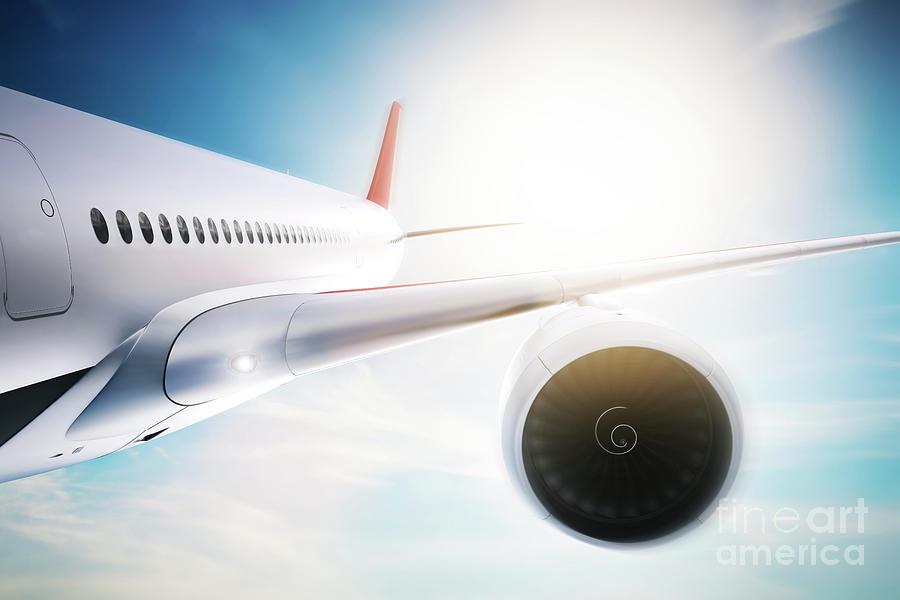 Passenger Airplane Flying At Sunshine, Blue Sky. Photograph