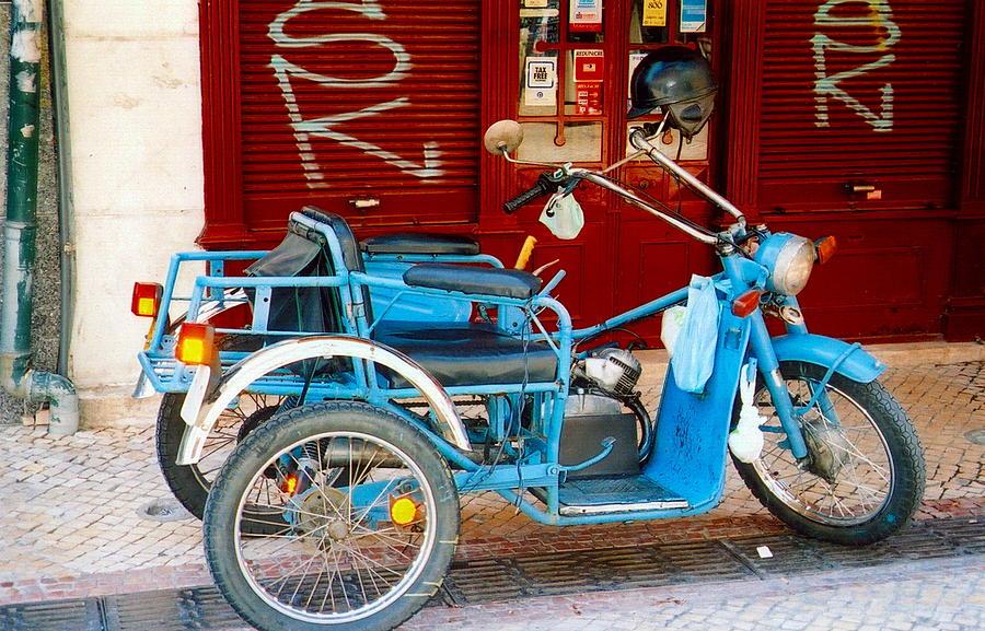 Portugal Photograph - Portuguese Wheels by Andrea Simon