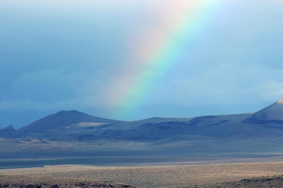 Rainbow in the desert by Jodi Vetter