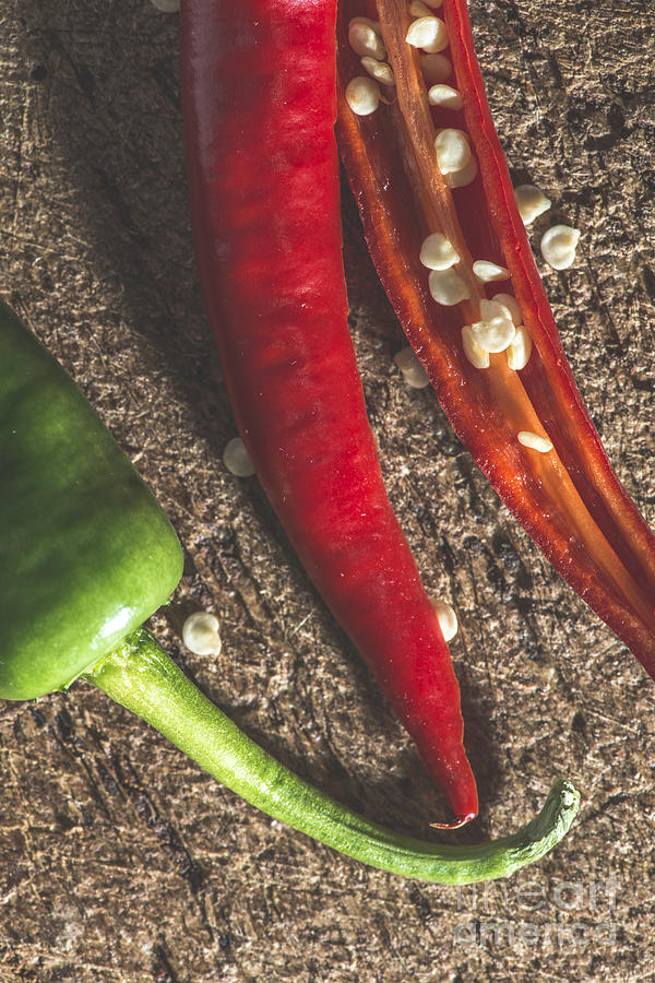 Background Photograph - Red Hot Peppers On Wooden  Cutting Board by Deyan Georgiev
