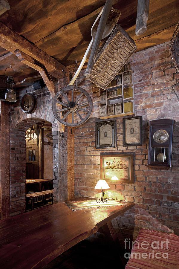 Artwork Photograph - Rustic Restaurant Seating by Jaak Nilson