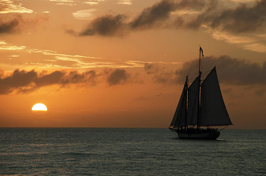 Sailing into the Sunset Photograph by Robert Shard