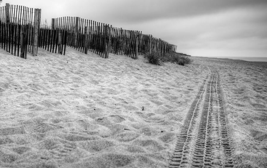 Snow fence on the beach by Chris Babcock