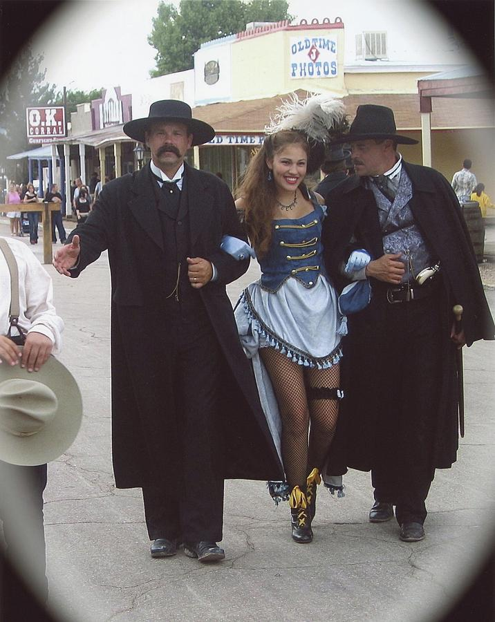 Wyatt Earp  Doc Holiday Escort  Woman  With O.k. Corral In  Background 2004 Photograph by David Lee Guss