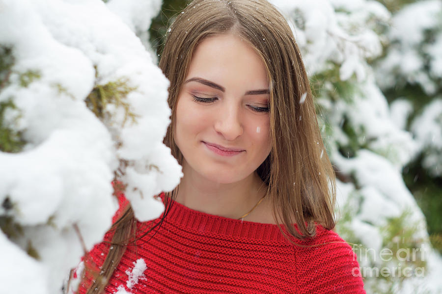 Winter Photograph - Beautiful Young Girl Model In Winter In A Parked Park. In A Red Sweater. by Oleksandr Masnyi