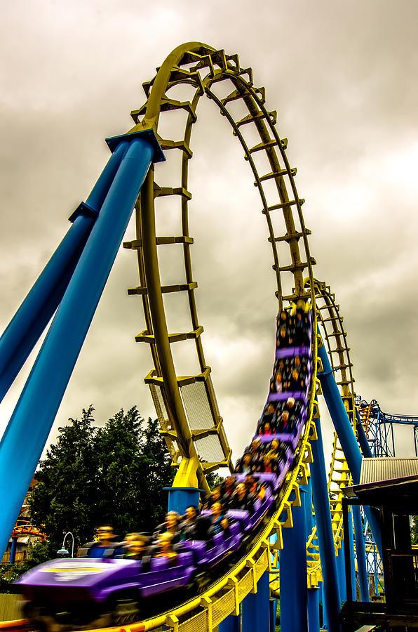 Crazy Rollercoaster Rides At Amusement Park Photograph