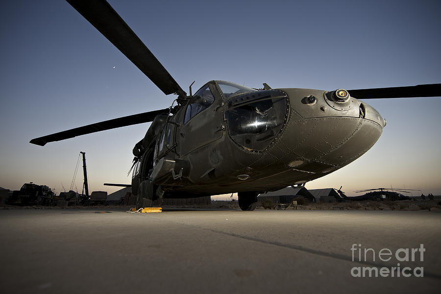 Isaf Photograph - A Uh-60l Blackhawk Parked On Its Pad by Terry Moore