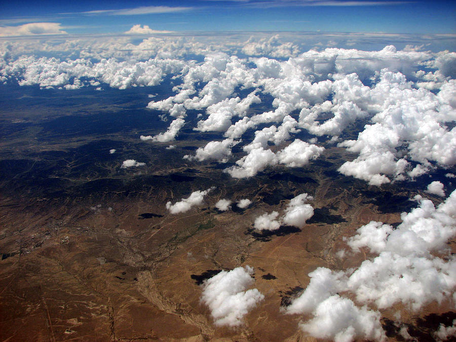 Clouds Photograph - Across The Miles by Joanne Coyle