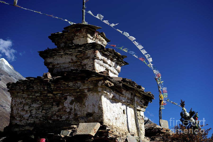 Buddhist gompa and prayer flags in the Himalaya range, Annapurna region, Nepal by Raimond Klavins