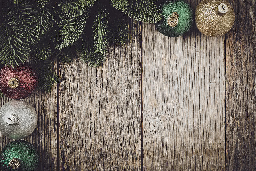 Christmas Wood Background.Christmas Pine Needle And Ornaments On A Rustic Wood Background