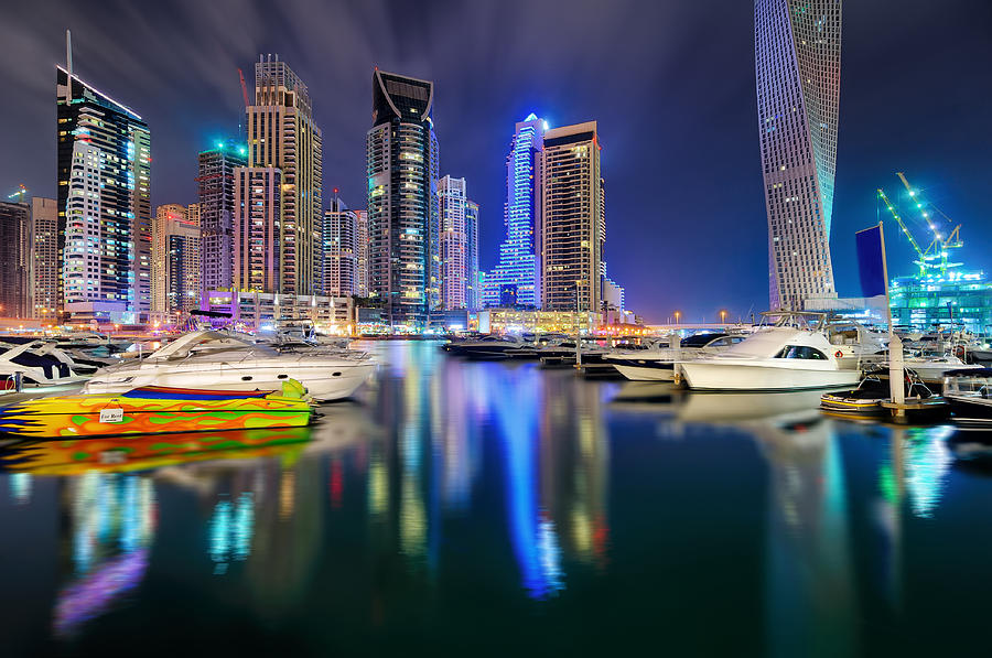 Arab Photograph - Colorful Night Dubai Marina Skyline, Dubai, United Arab Emirates by Marek Kijevsky