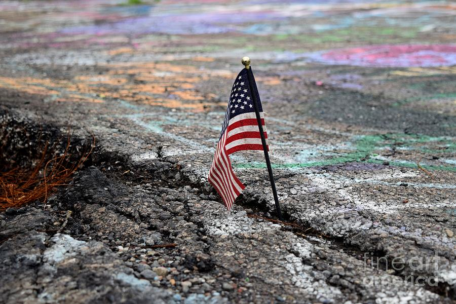 May Photograph - Flag In A Crack In The Pavement by Ben Schumin