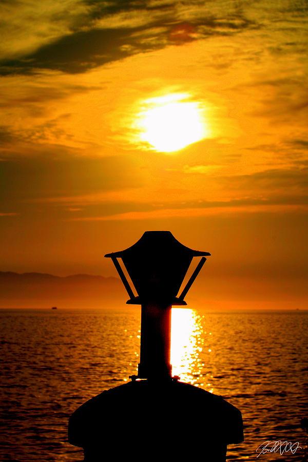 Puerto Vallarta Photograph - Light At Sunset by Jason Blalock