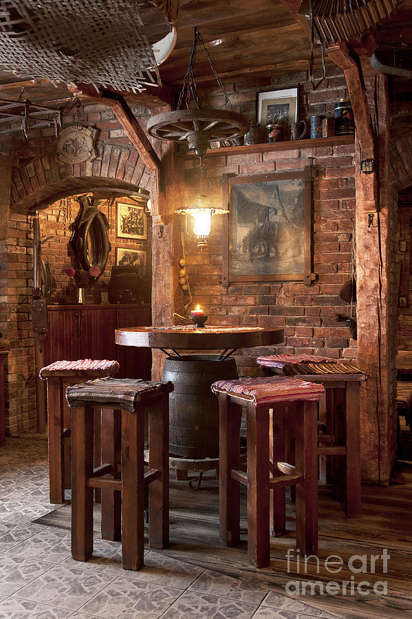 Artwork Photograph - Rustic Restaurant Seating by Jaak Nilson