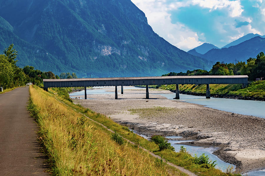 Bridge Photograph - The Alte Rheinbrucke Across The River Rhine Between Liechtensti by Ben Gingell