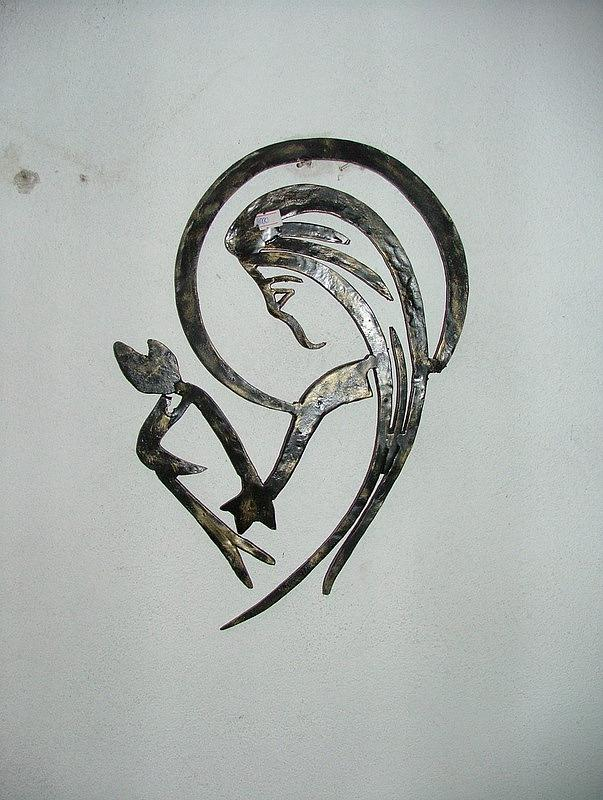 Woman In Wrought Iron Relief by Petrit Metohu