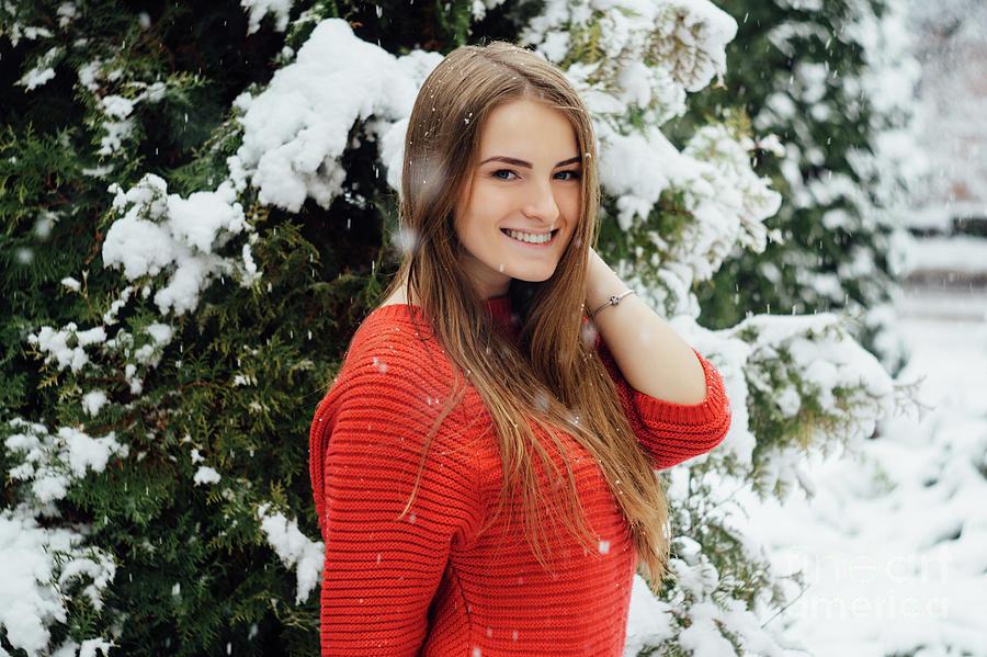 Snow Photograph - Beautiful Young Girl Model In Winter In A Parked Park. In A Red Sweater. by Oleksandr Masnyi