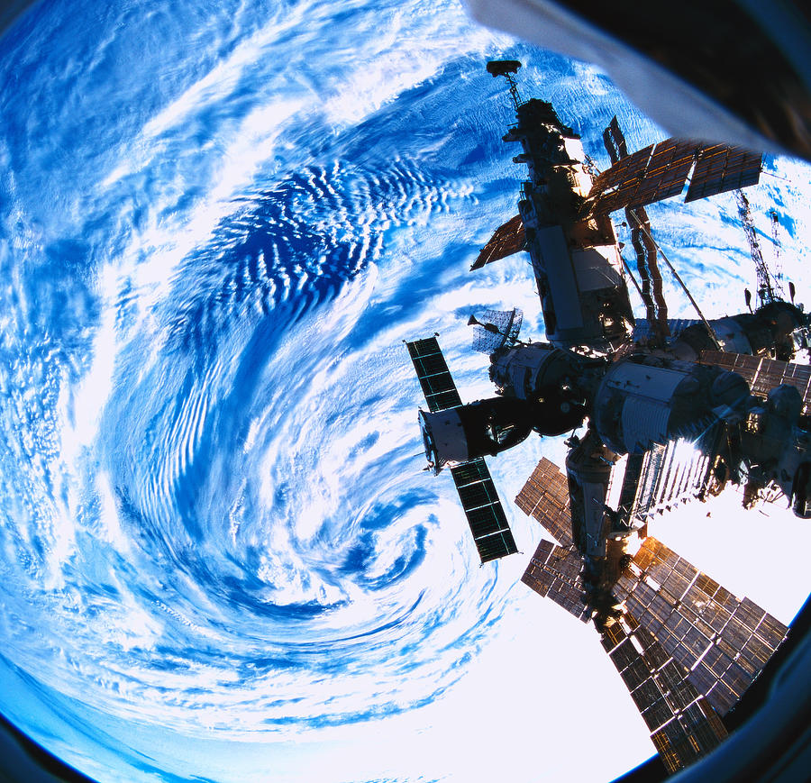 A Space Station Orbiting Above Earth Photograph by Stockbyte
