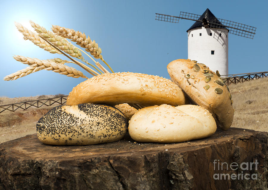 Agriculture Photograph - Different Breads And Windmill In The Background by Deyan Georgiev