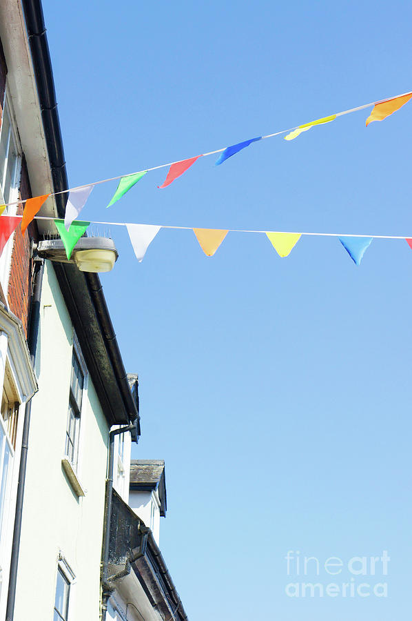 Architecture Photograph - Street Bunting Flags by Tom Gowanlock