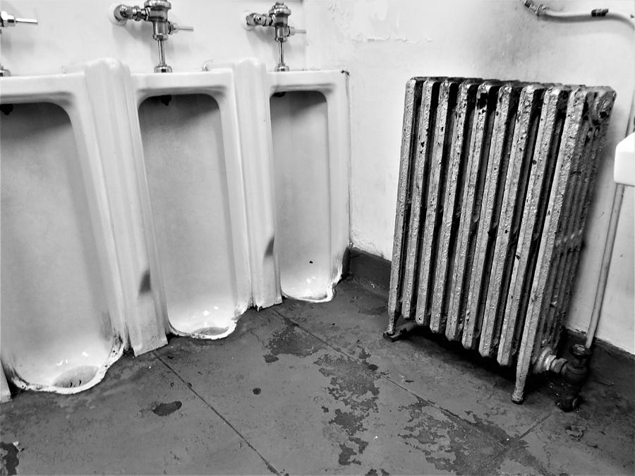 3 Urinals 1 Radiator And Part Of A Sink Photograph