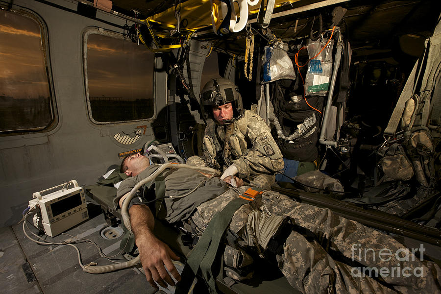 Blackhawk Photograph - U.s. Army Specialist Practices Giving by Terry Moore