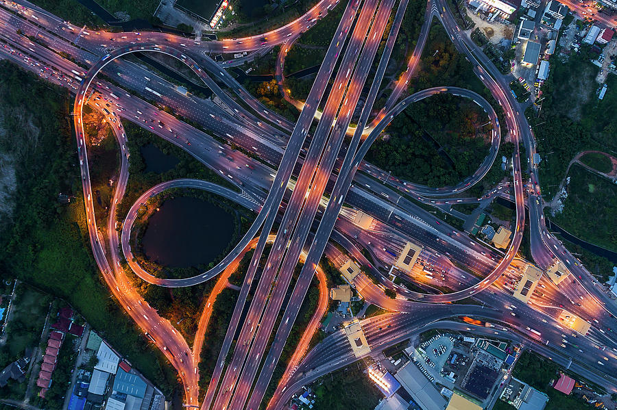 Aerial view of traffic jams at Nonthaburi intersection in the evening, Bangkok. by Pradeep Raja PRINTS