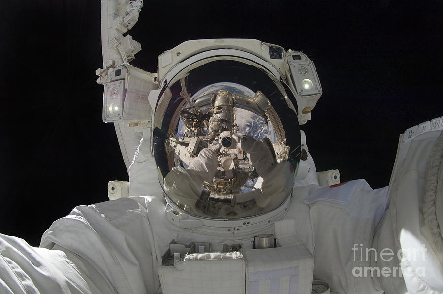 Color Image Photograph - Astronaut Uses A Digital Still Camera by Stocktrek Images