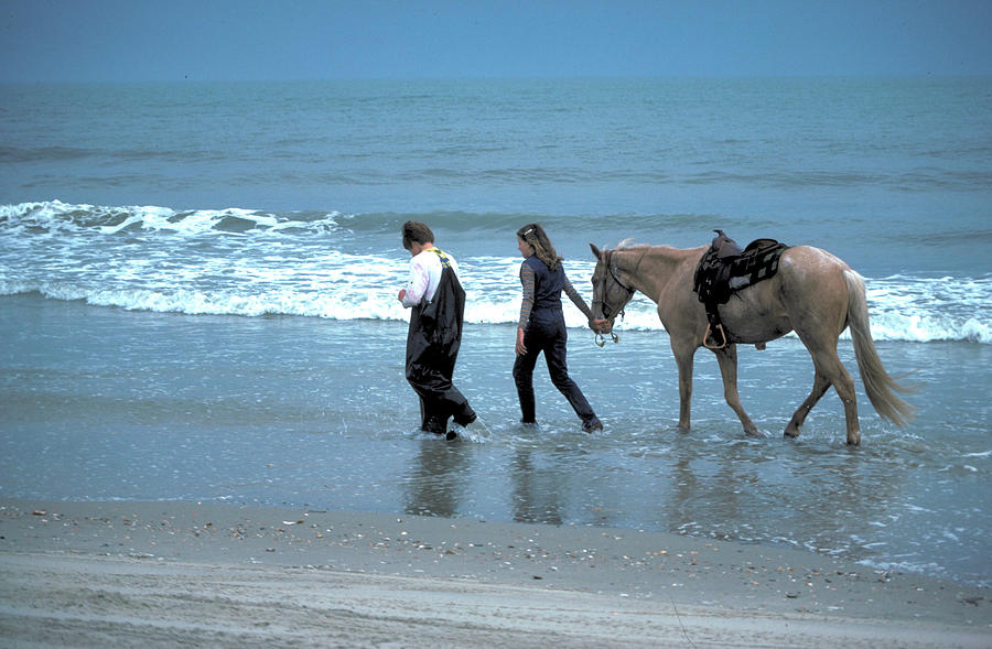 Couple with Horse on Outer Banks by Carl Purcell