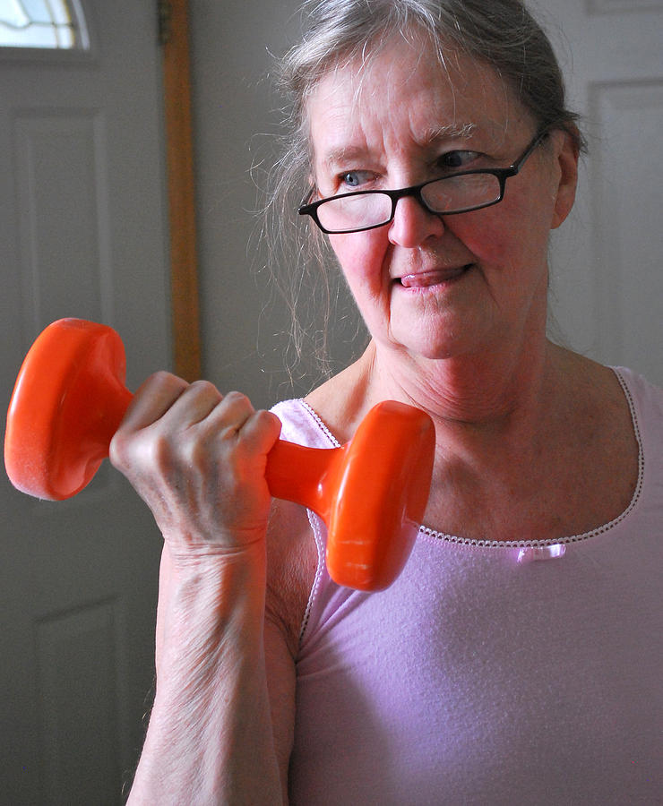 Mature Photograph - Female Workout. by Oscar Williams