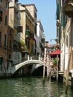 Venice Photograph - Venetian Bridge With Candy Striped Poles by Stephanie Elenbaas