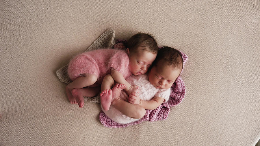 Two Twins Newborn Sleeping Photograph