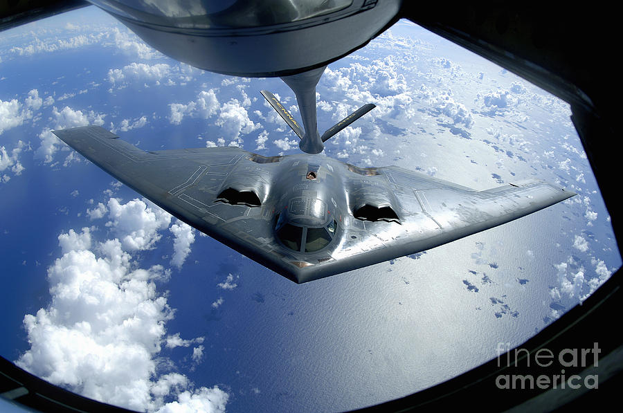 Color Image Photograph - A B-2 Spirit Moves Into Position by Stocktrek Images