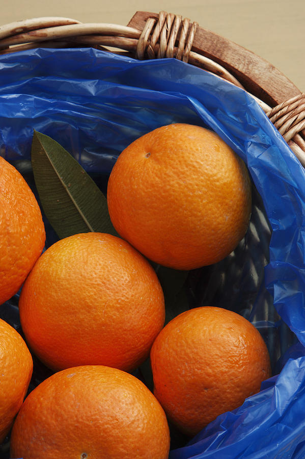 Crete Photograph - A Basket Of Oranges by Steve Outram