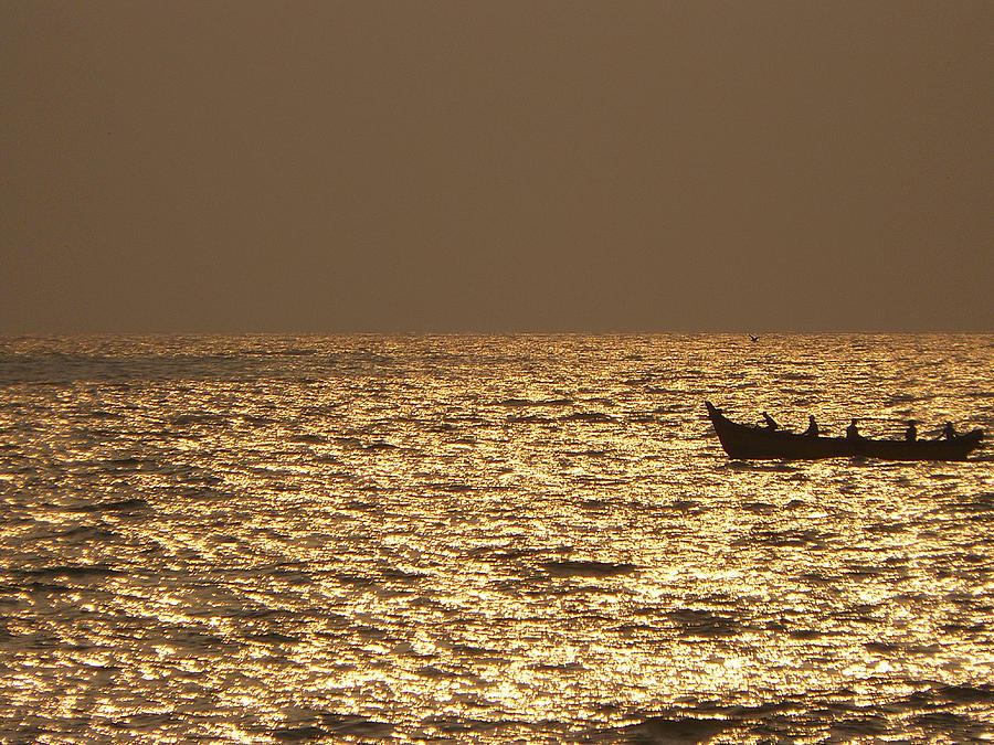 Sunset Photograph - A Boat Against A Golden Sunset by Sandeep Gangadharan