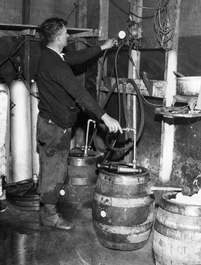 1930s Photograph - A Brewmeister Fills Kegs At A Bootleg by Everett